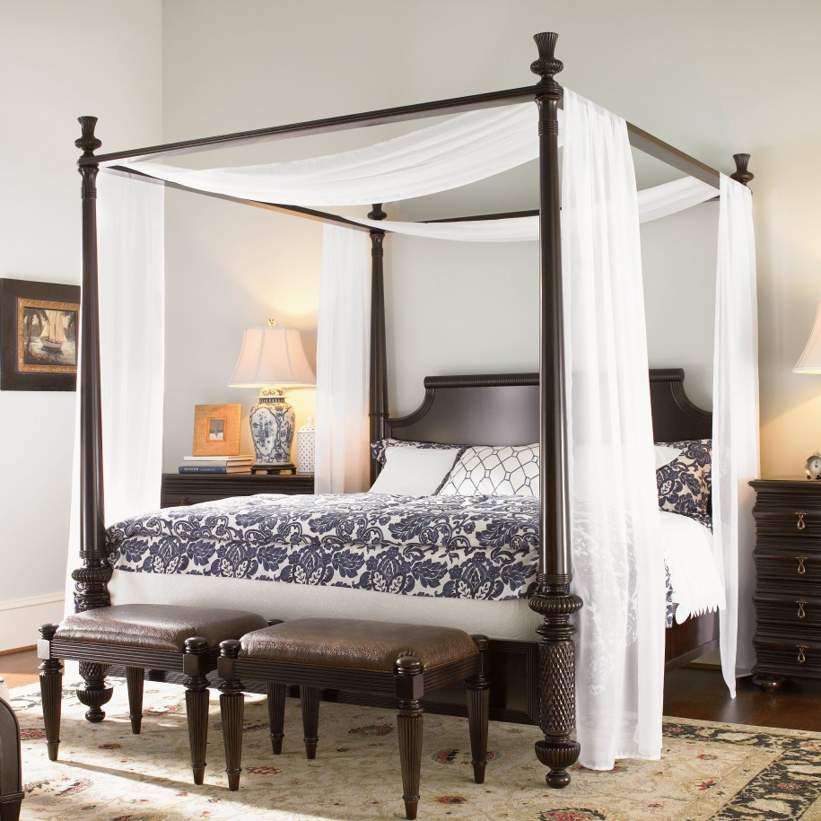Brown Oriental Rug With Wooden Canopy Bed
