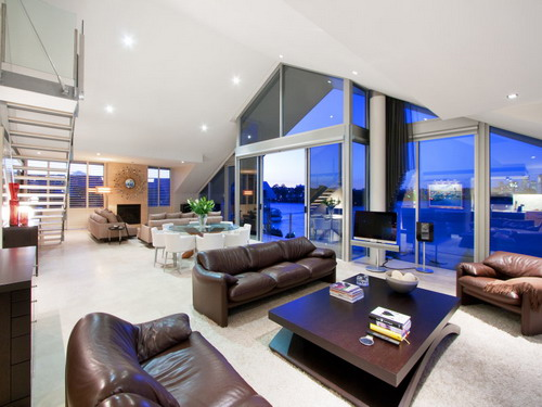 Comfortable-Brown-Leather-Sofa-In-A-Modern-Living-Room-Wiith-Beach-View