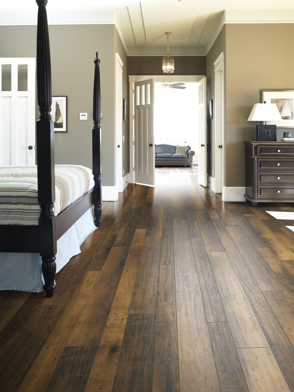 Cool Bedroom with dark brown floors or black furniture
