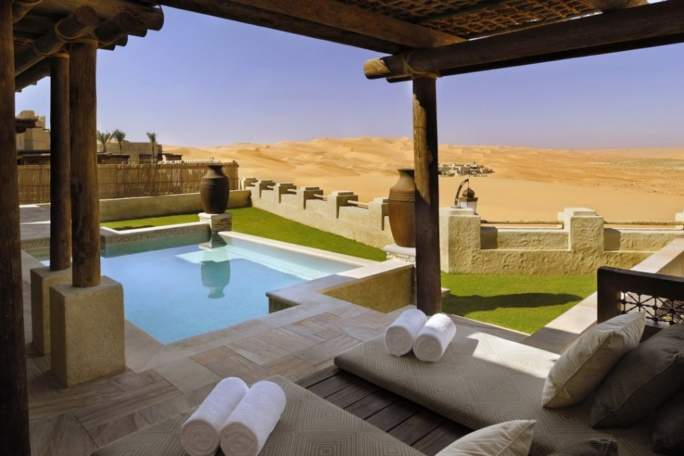 Relaxing-space-dessert-resort-with-cream-lounge-chairs