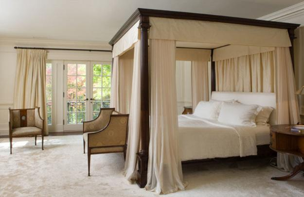 Wooden bed with light canopy curtains