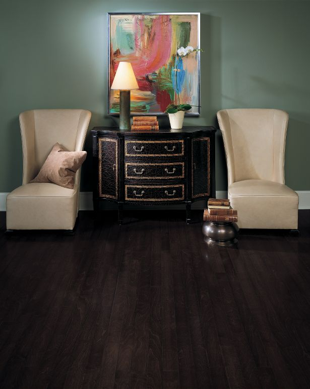 dark hardwood floors bedroom with sofa