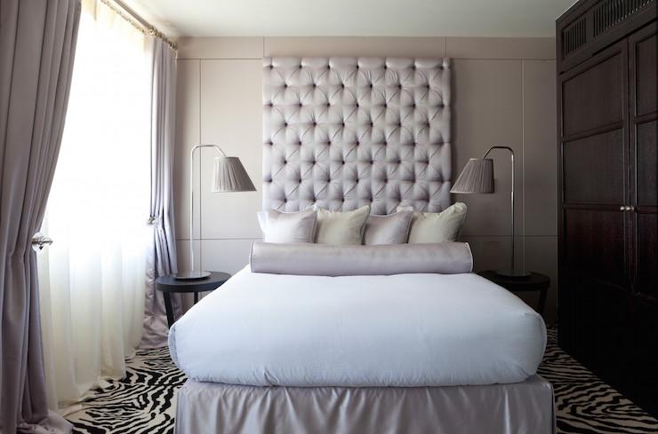 tall-tufted-gray-headboard-gray-bedskirt-zebra-rug