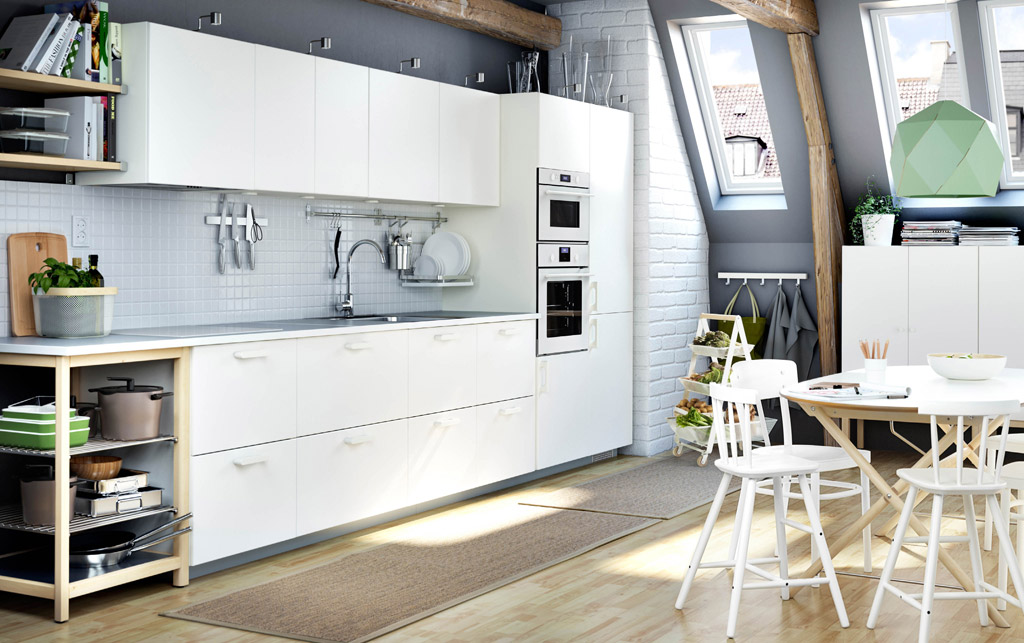 A white kitchen with light grey worktops