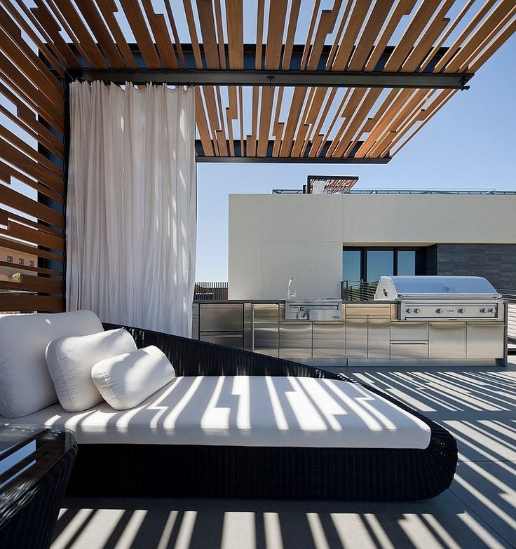 Contemporary steel and timber cantilevered pergola