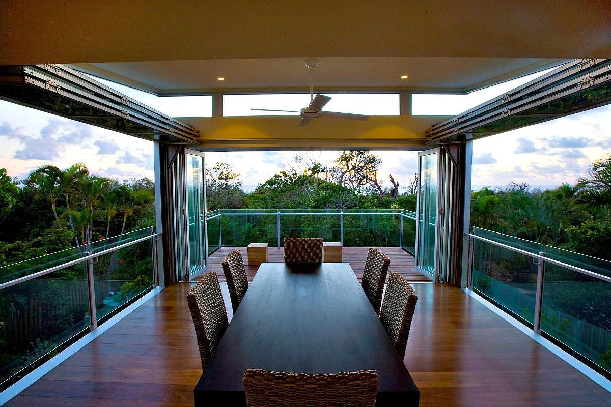 Dining Room Design In Open Space With Glass Fence