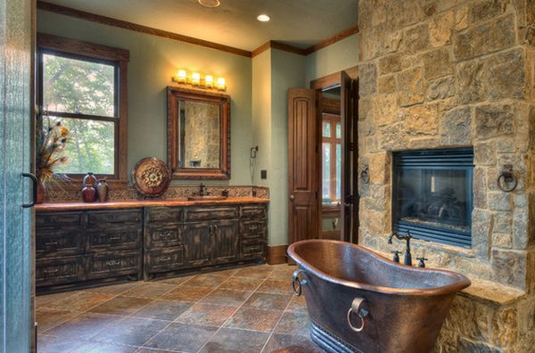 elegant cooper bathtub with stone wall fireplace