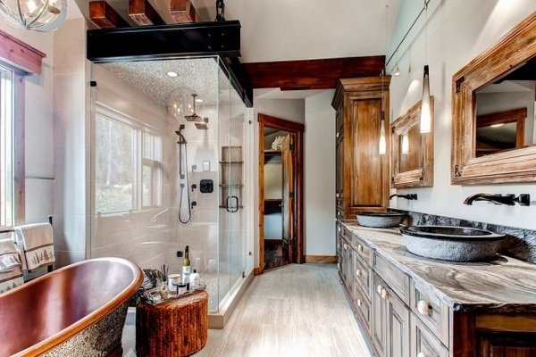 Luxury Bathroom with Wood Vanity Cabinets & Cooper Tub