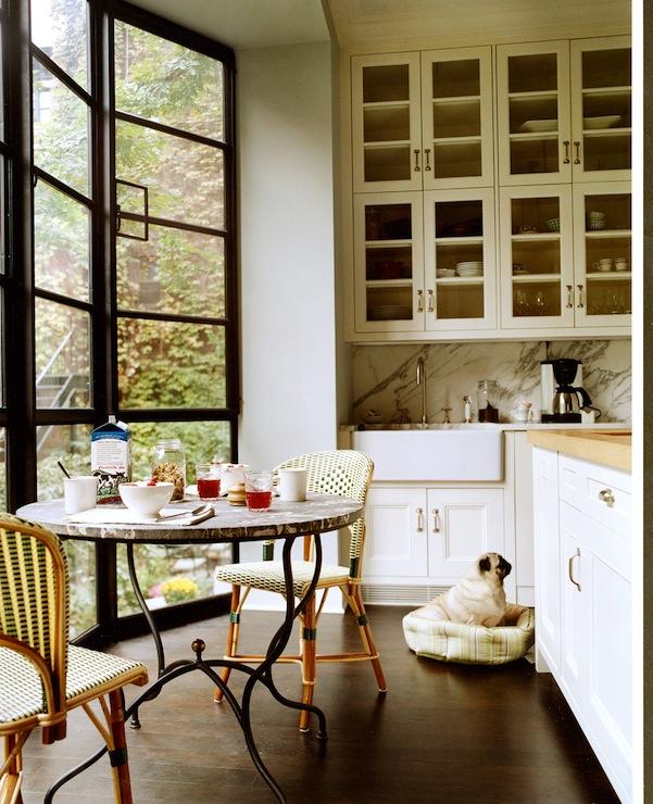 Modern breakfast nook design with black folding doors