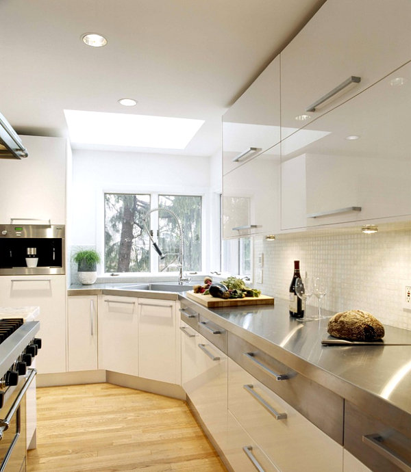 Modern white kitchen with stainless steel countertops