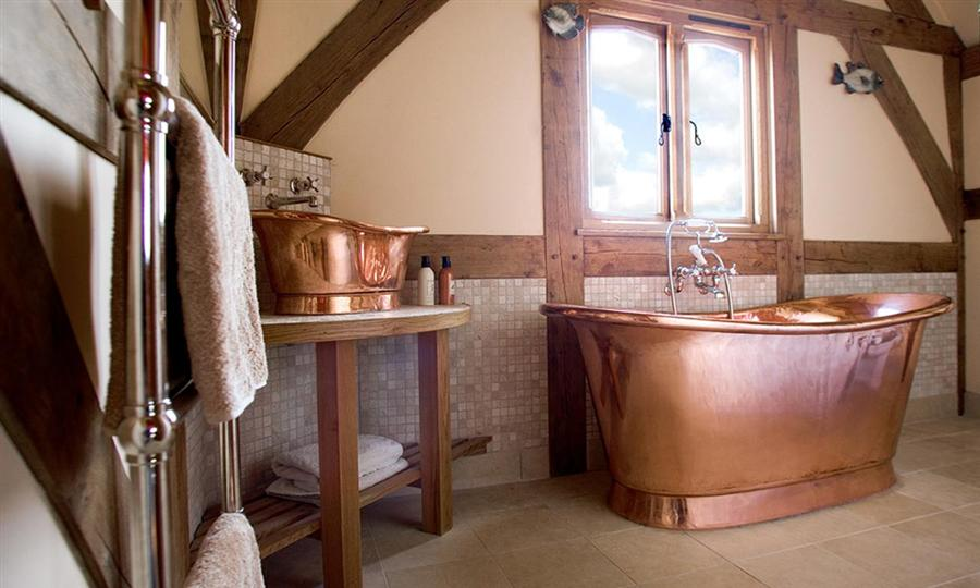 Rustic Bathroom with Copper Bathtub Incorporated with Wood Materials