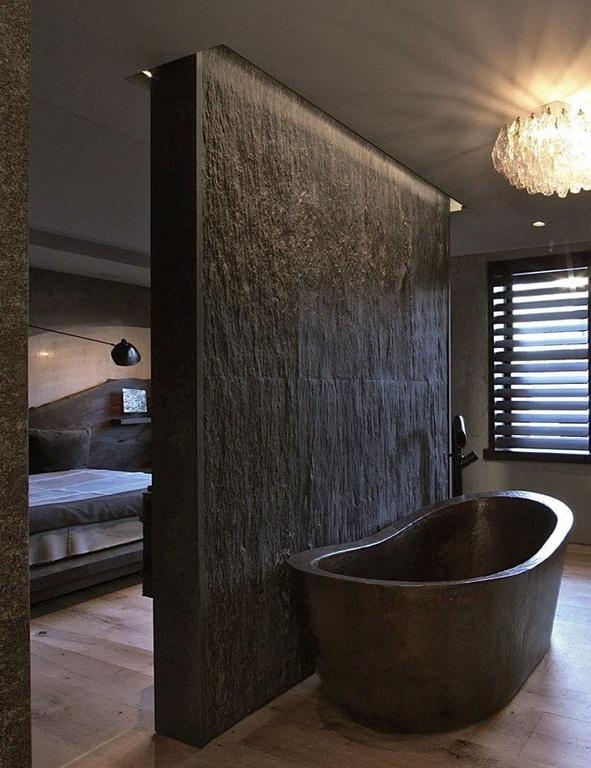 Rustic Master Bathroom with Stone Clad Wall & Copper Bathtub