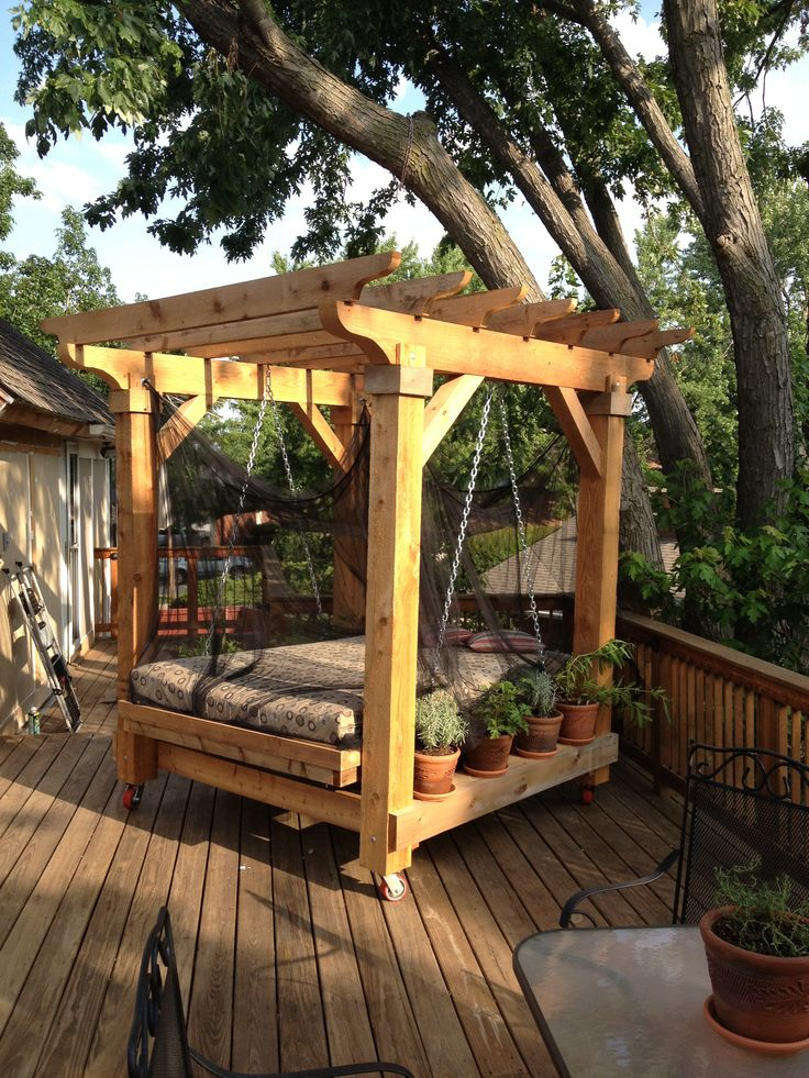 Swinging Bed With Wooden Canopy