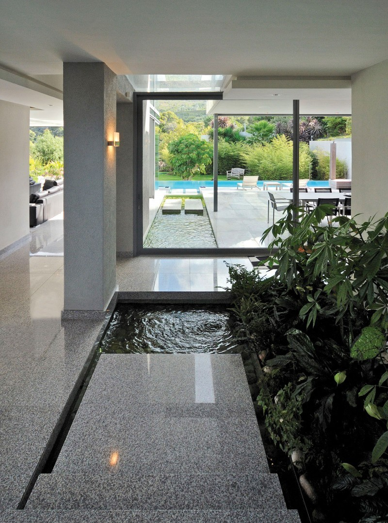 Beautiful grey granite flooring with small pond and inddor artifical plantation.