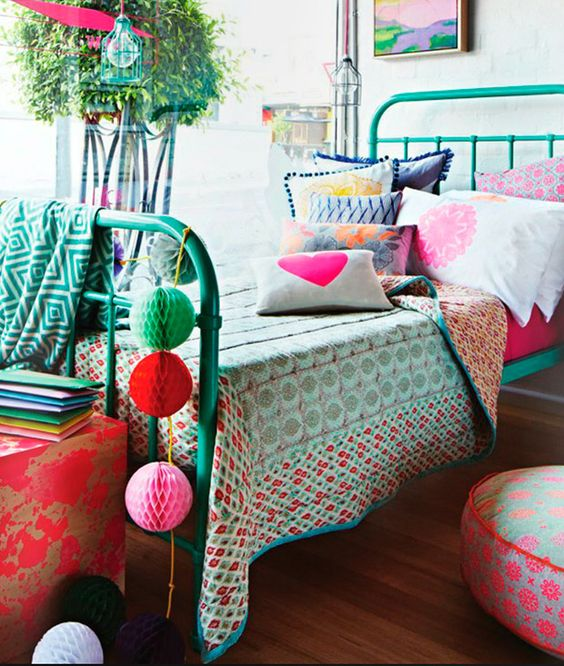 Eclectic girls bedroom with turquoise iron bed and colorful accessories