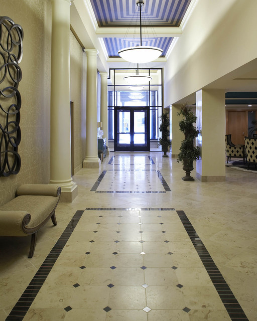 Long lobby covered with beautiful marbles and pillars