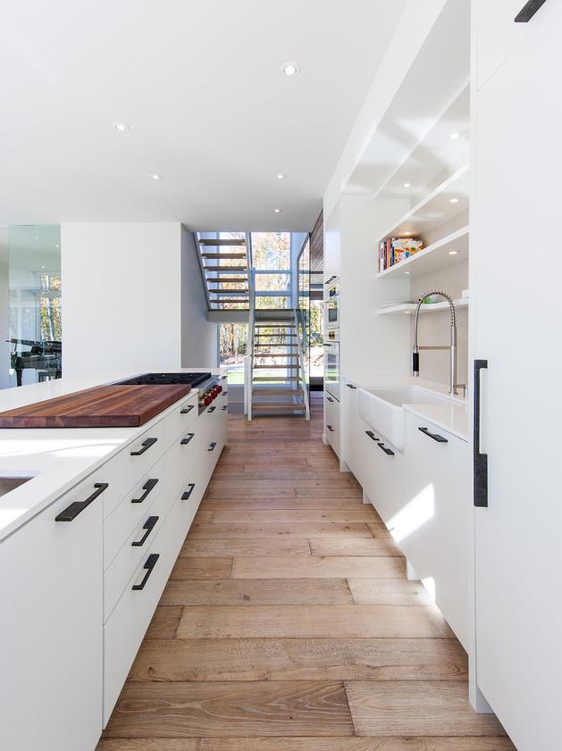 Open Kitchen with Reclaimed Wood Floor