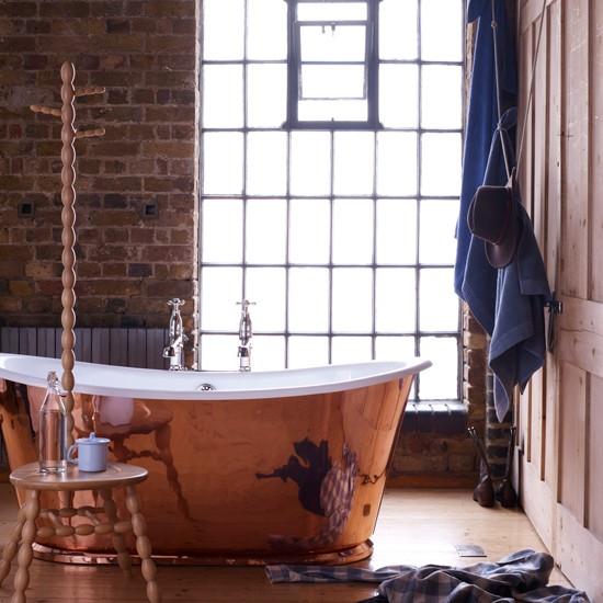 Rustic bathroom with copper bathtub