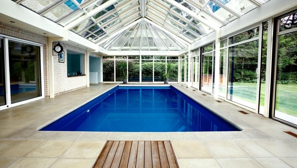 25 bold beautiful contemporary swimming pool designs for Inground indoor pool designs