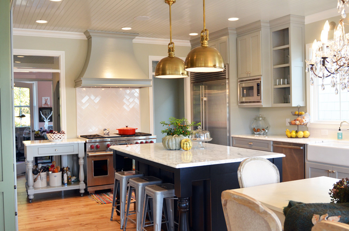 gray island kitchen with brass fixtures