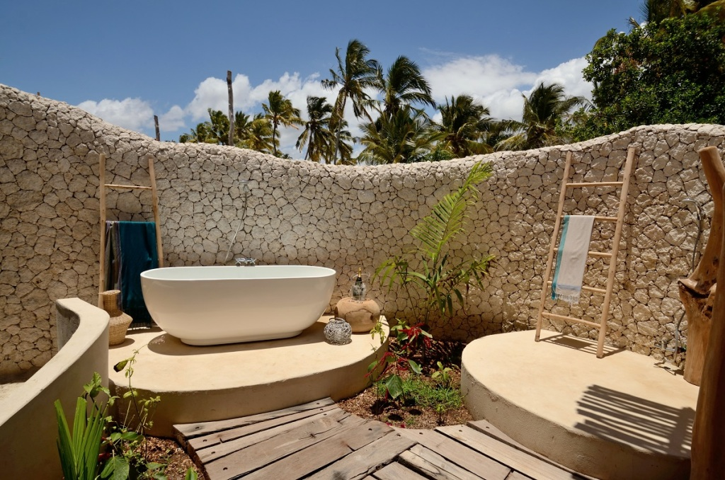 open air white sands outdoor shower and bathtub