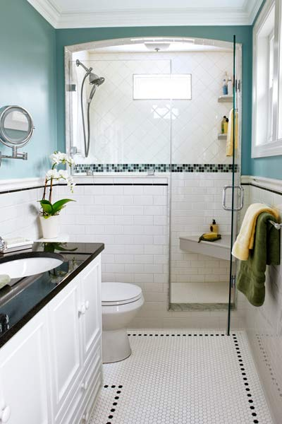 small white bathroom with mosaic tiles