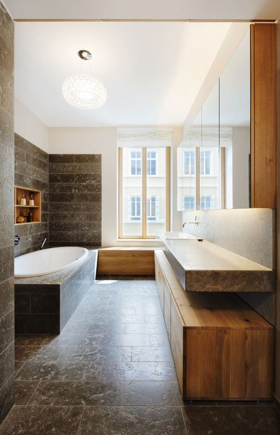 Bathroom with wooden furniture and granite flooring