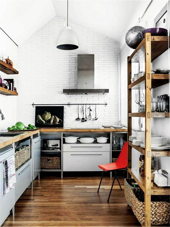 Eclectic Kitchen with dark wood flooring and shelf