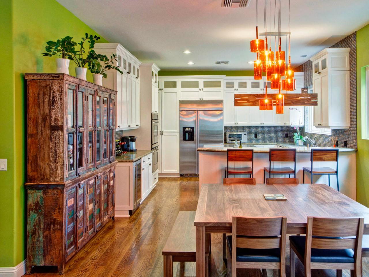 Green Eclectic Kitchen With Orange Pendant Lamps