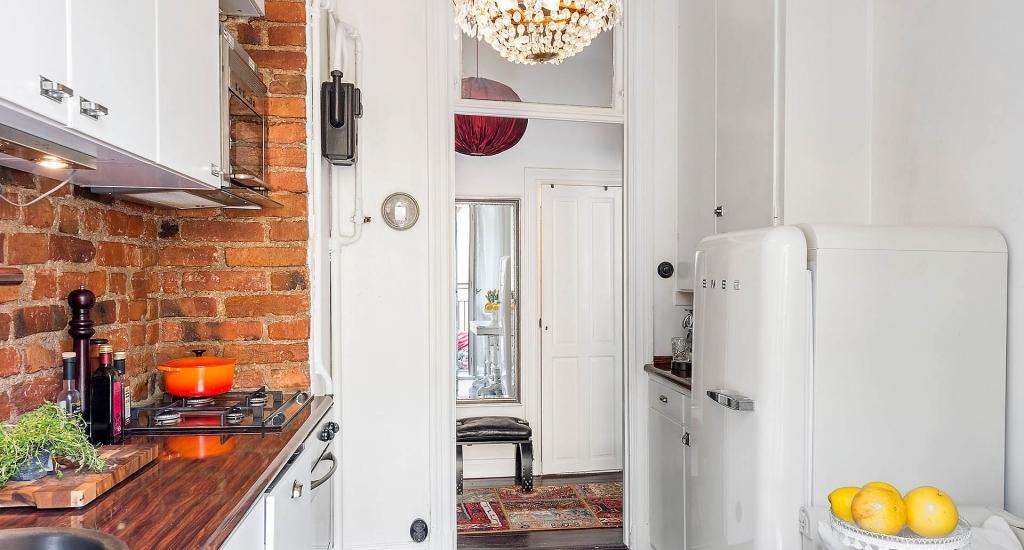 Kitchen-chandelier and wooden countertop