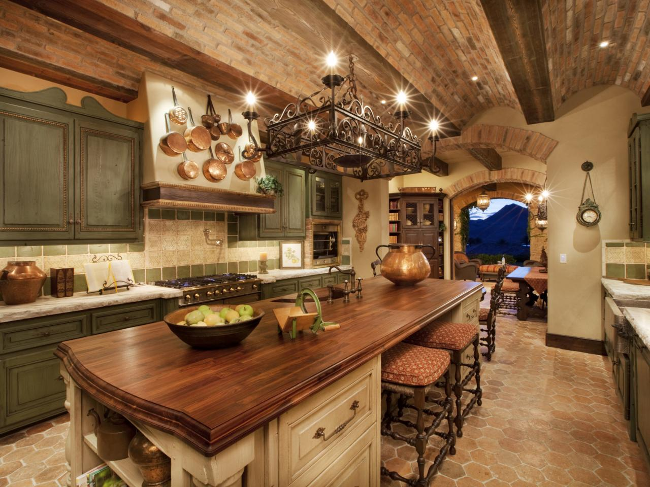 Tuscan Kitchen With Sage Cabinets and Brick Ceiling