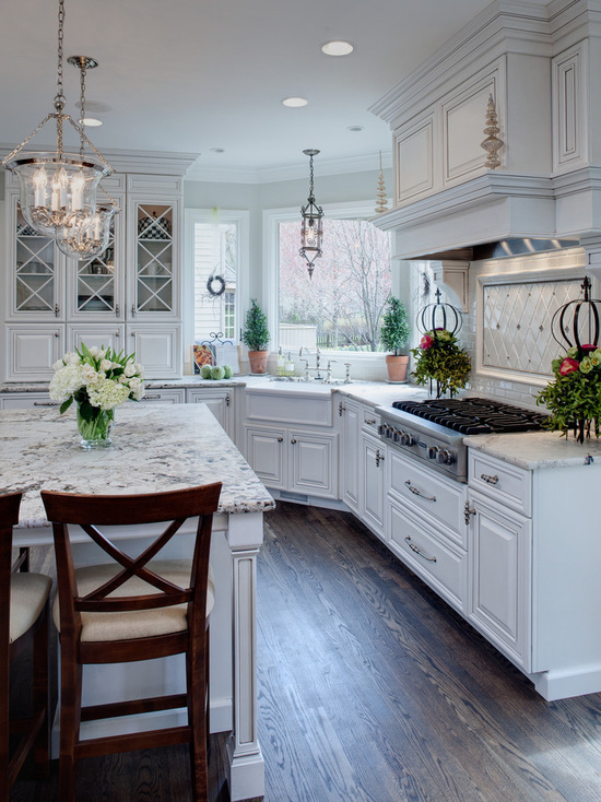 White traditional-kitchen with dark wooden flooring