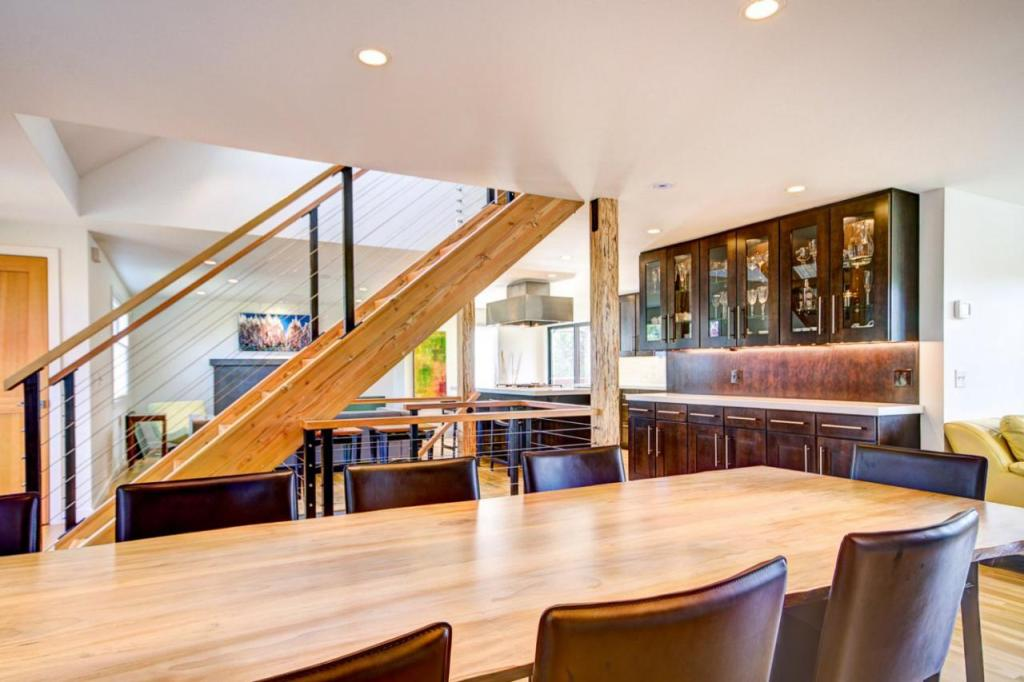 Asian Dining Room Features Leather Seating & Bar Area
