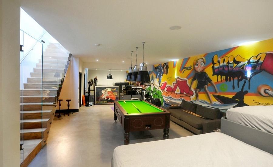 Bright and colorful graffiti in the chic contemporary basement