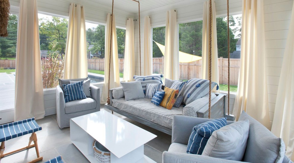 Chic wooden porch swings in Beach Style