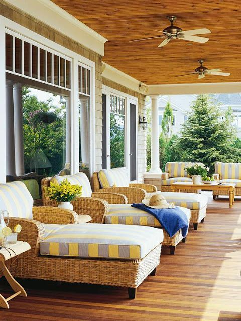 Coastal porch with wicker chaise loungers