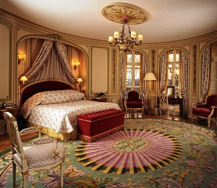 Mediterranean Master Bedroom with Hardwood floors