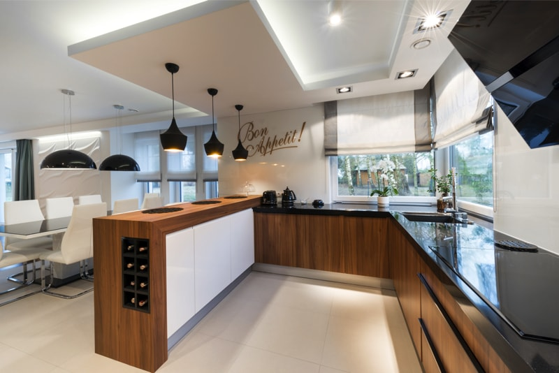 Modern kitchen interior design in black, white style and wood