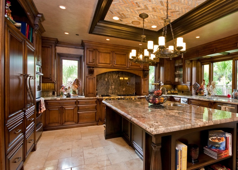 Traditional Kitchen with U-shaped, Complex granite counters, High ceiling, Brick red