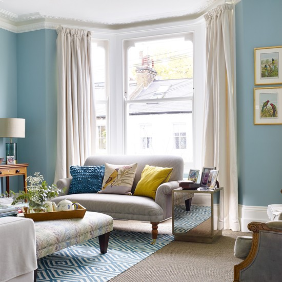 Traditional living room with vivid blue walls