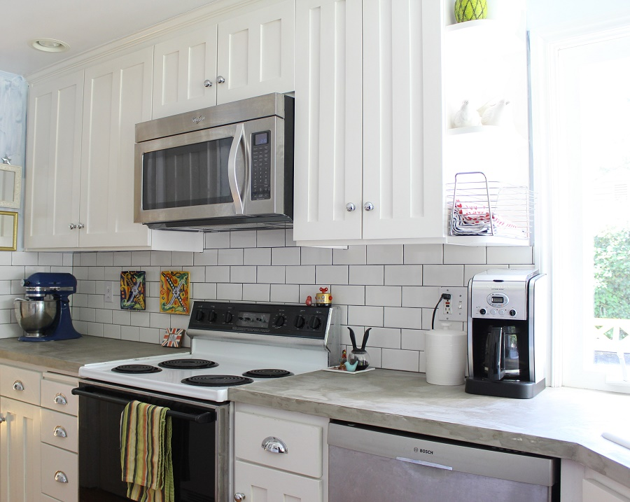 White Wooden Cabinets With Subway Wall