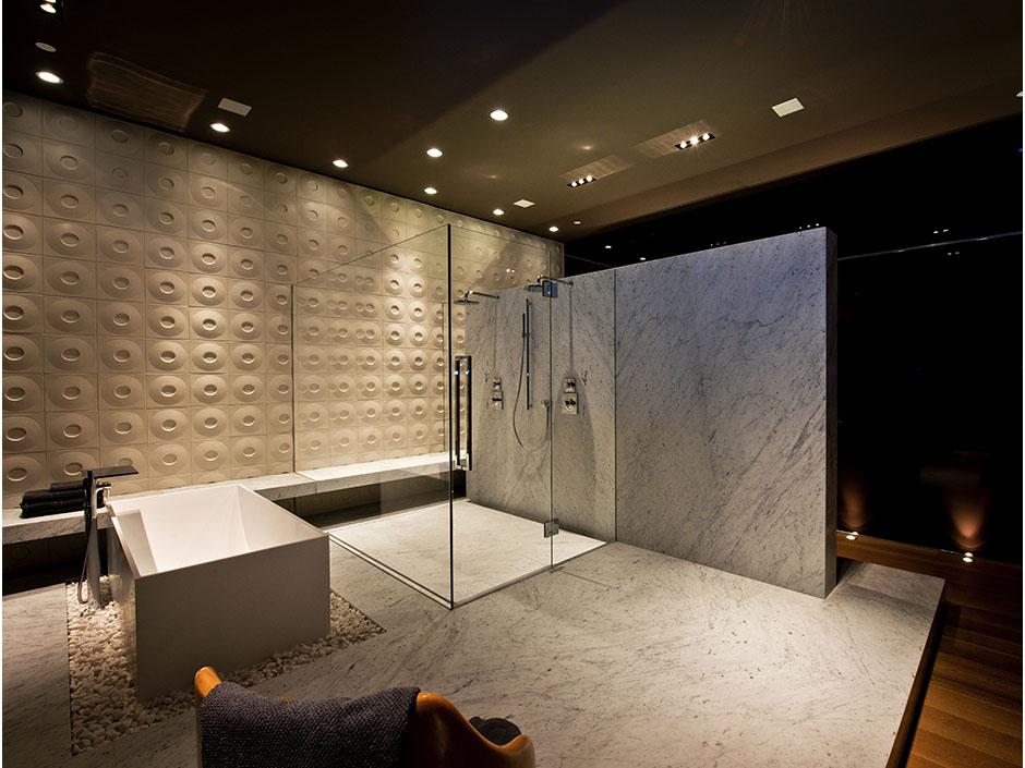 large modern luxury bathroom with huge shower cabin by the modern bathtub