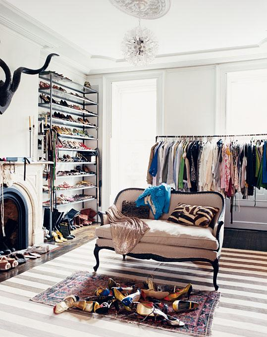 Chic closet design with stone fireplace