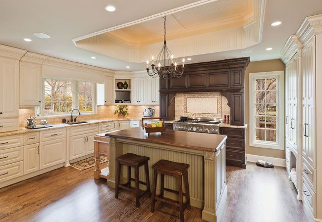 Clad mostly in cream-colored cabinets, this traditional kitchen in ...