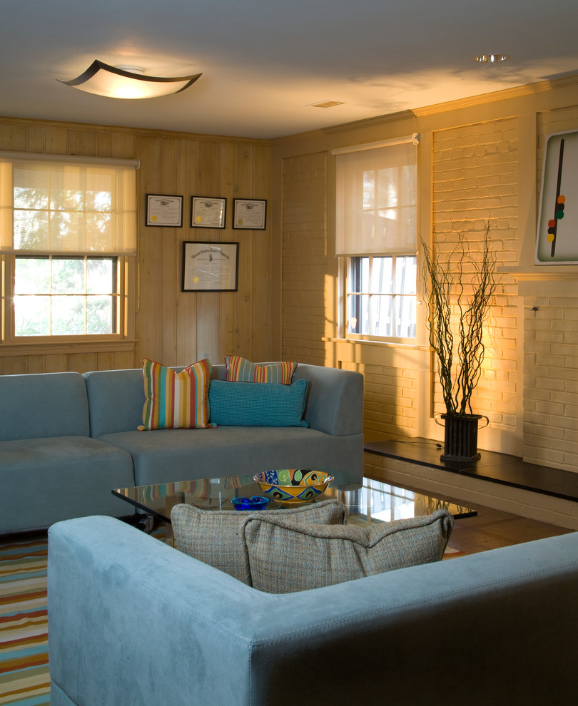 Eclectic Basement with Beige Brick Fireplace