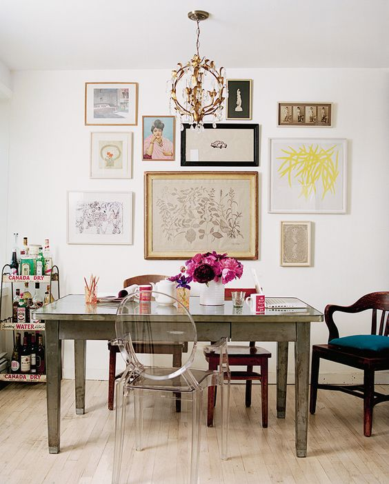 Eclectic dining room featuring a lovely gallery wall