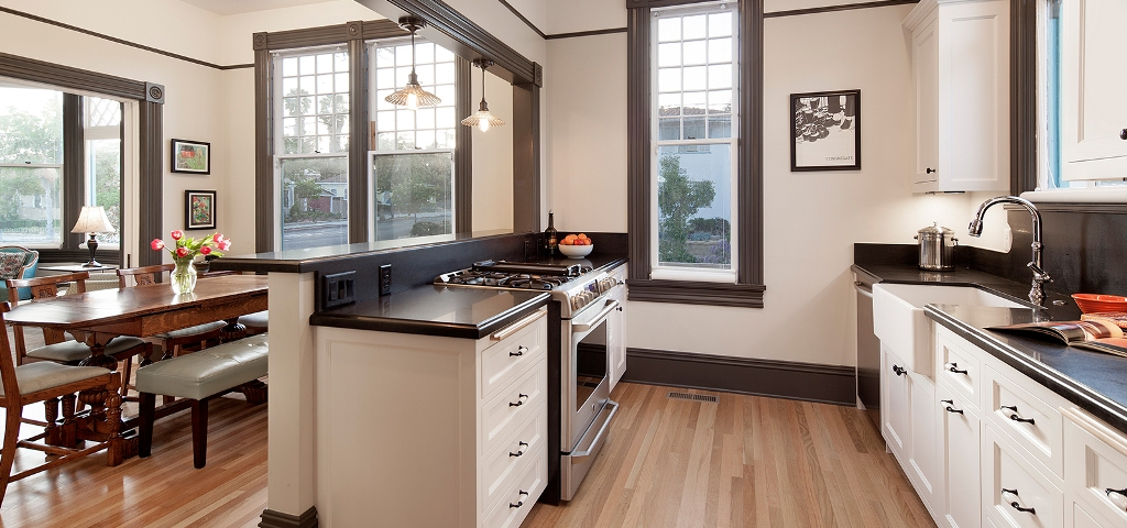 Galley kitchen remodel with wood flooring