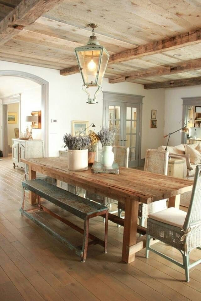 rustic dining room with farmhouse table and eclectic chair set