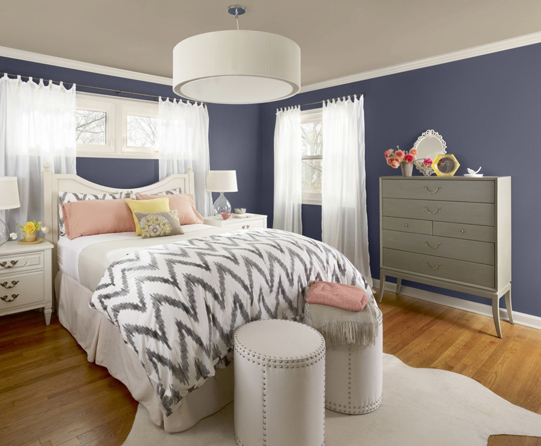 bedrooms-exquisite-bright-bedroom-with-white-solid-wood-nightstand-table-and-blue-denim-wall-painting-also-white-cowhide-rug-and-black-zig-zag-pattern-bed-cover