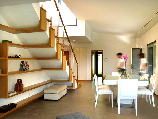 beautiful staircase with sleek shelves underneath